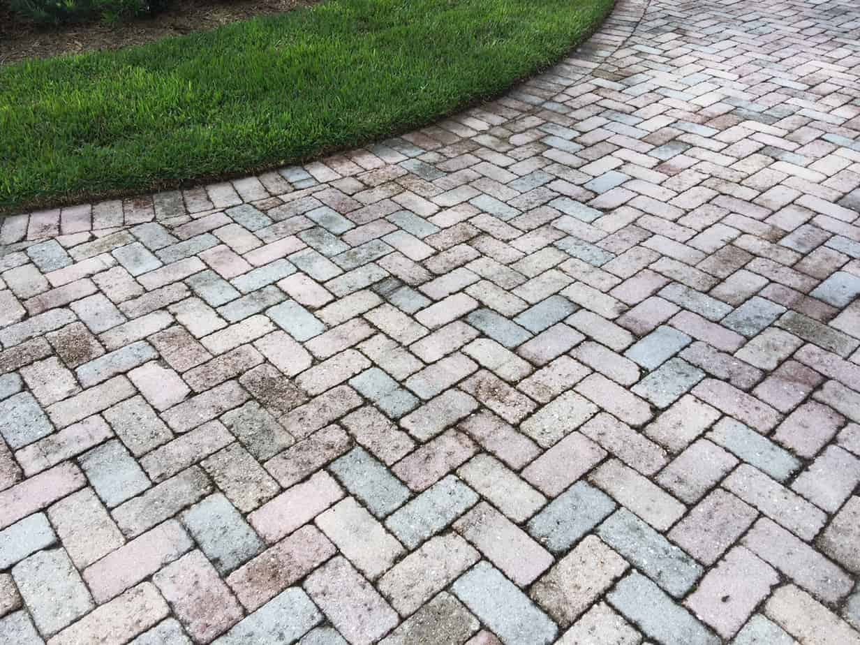 how to clean sand stone pavers